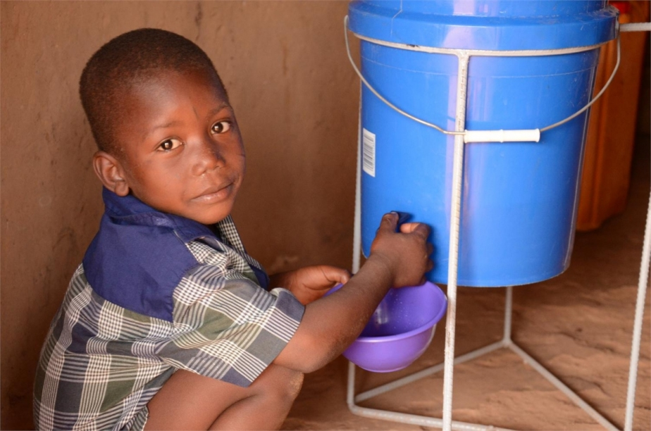 a young boy using a water filter