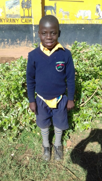 a boy in his Liberty School uniform