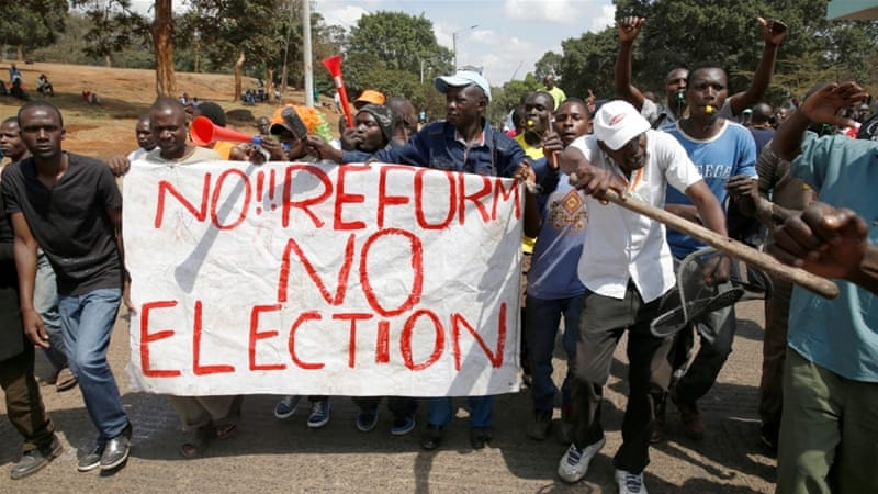 Kenyan protestors holding a sign that reads NO REFORM NO ELECTION