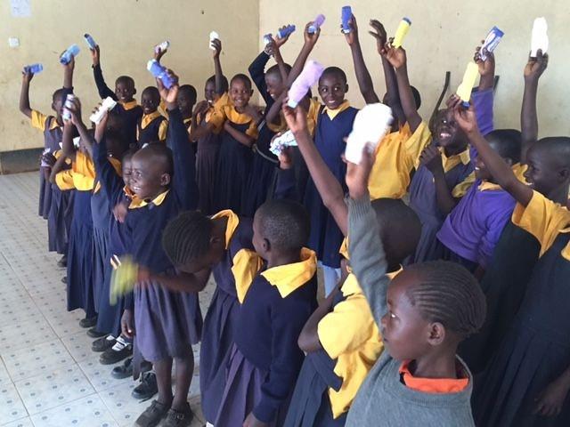 kids in school uniform holding up underwear